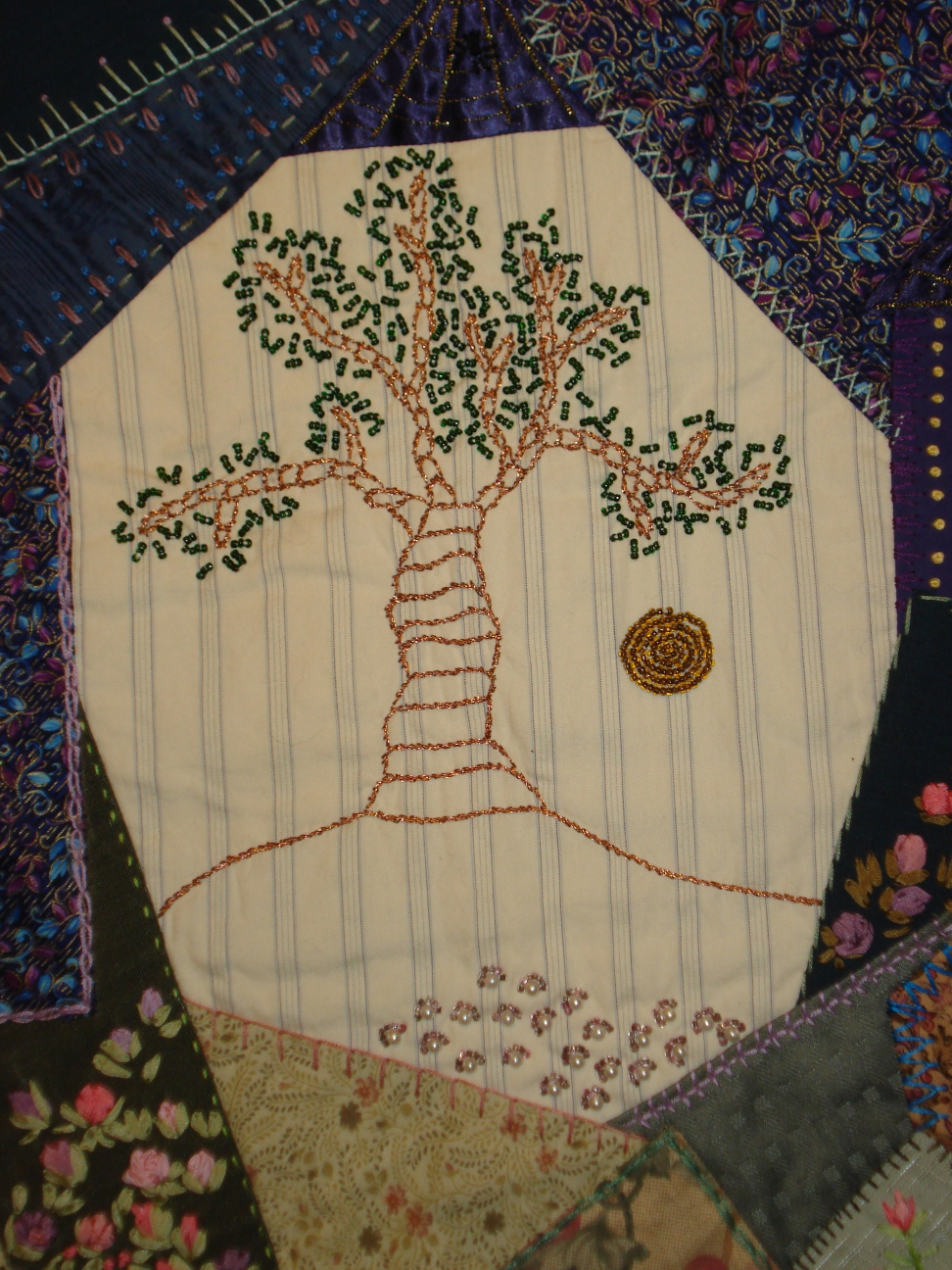 Crazy quilt wall hanging with embroidered and beaded tree, by Mary Warner.