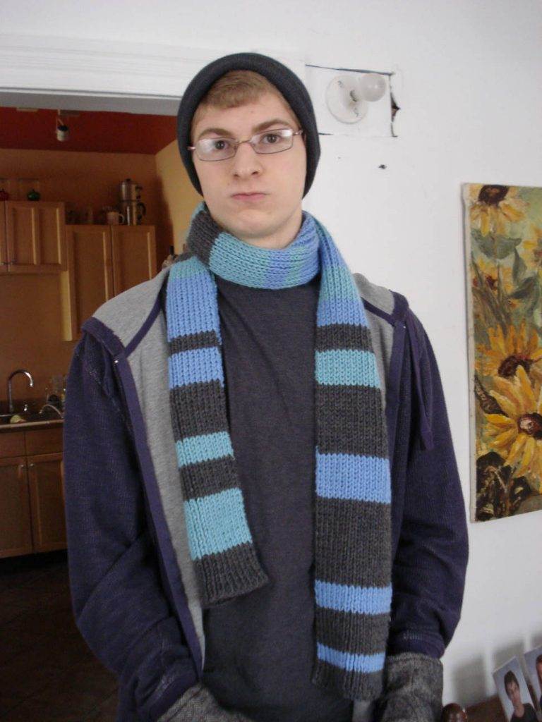 Knitted striped scarf on Sebastian, by Mary Warner, 2015.