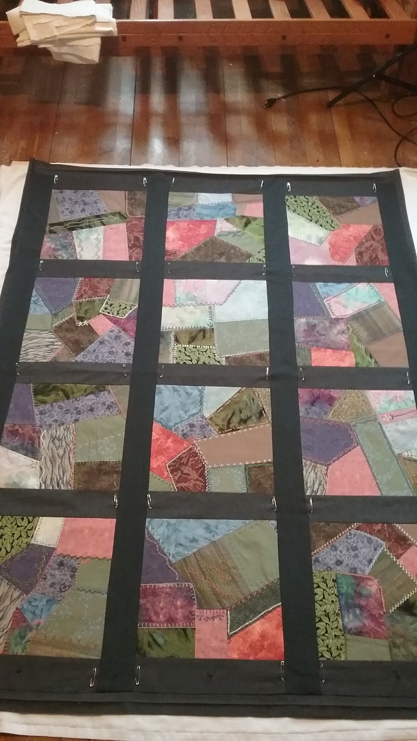 Three layers of crazy quilt pinned, ready for tying, by Mary Warner, April 2, 2017.