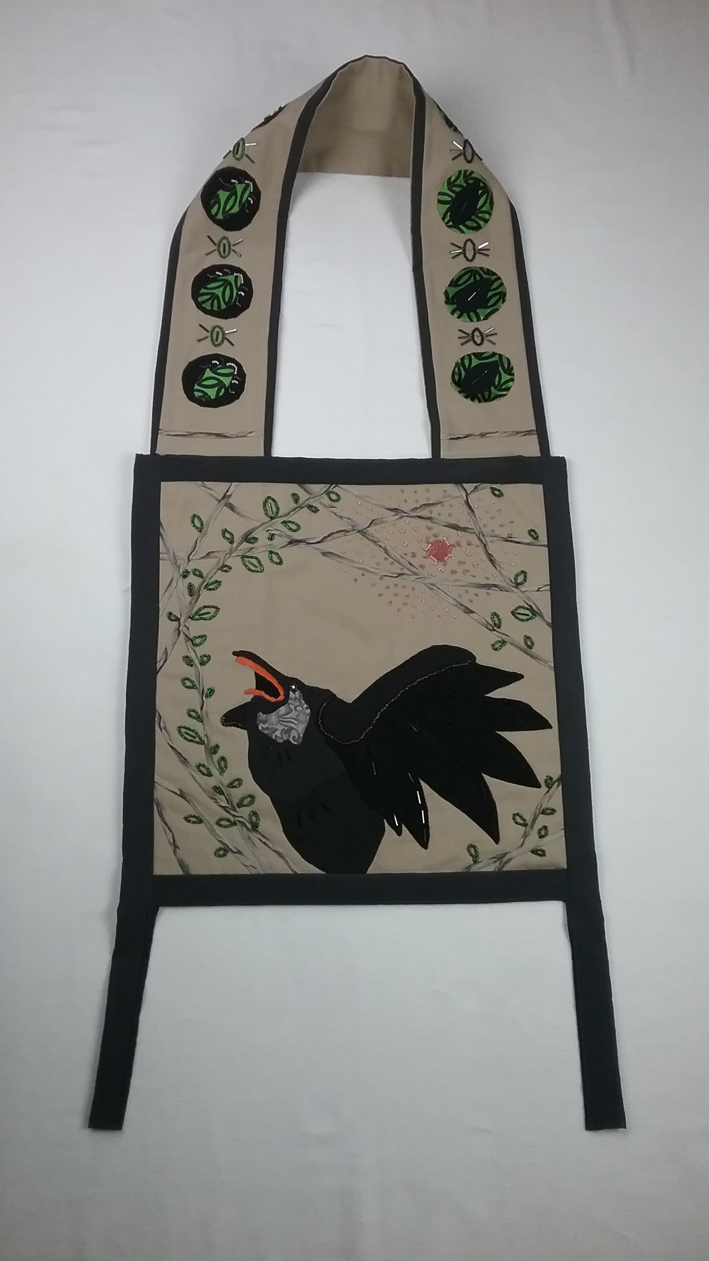 Corvid bag, applique and bead applique, bag structure inspired by Ojibwe bandolier bags, by Mary Warner, 2017. Note, corvids (crows & ravens) do not have orange beaks, so I've used artistic license on this.