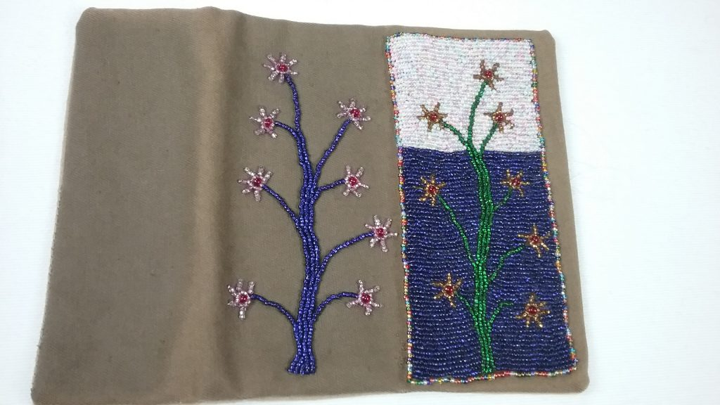Needle case, decorative side opened out, bead applique, by Mary Warner.
