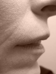 Sepia nose & mouth, self portrait by Mary Warner, 2015.