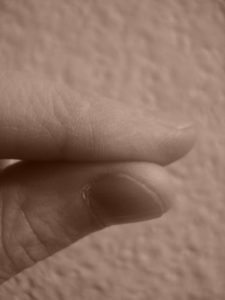 Sepia fingers, self portrait by Mary Warner, 2015.