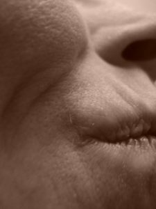 Sepia cheek, mouth & nose, self portrait by Mary Warner, 2015.