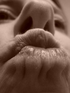 Sepia pucker, self portrait by Mary Warner, 2015.