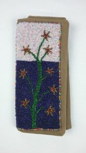 Needle case, front, bead applique, by Mary Warner.