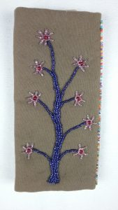 Needle case, back, bead applique, by Mary Warner.