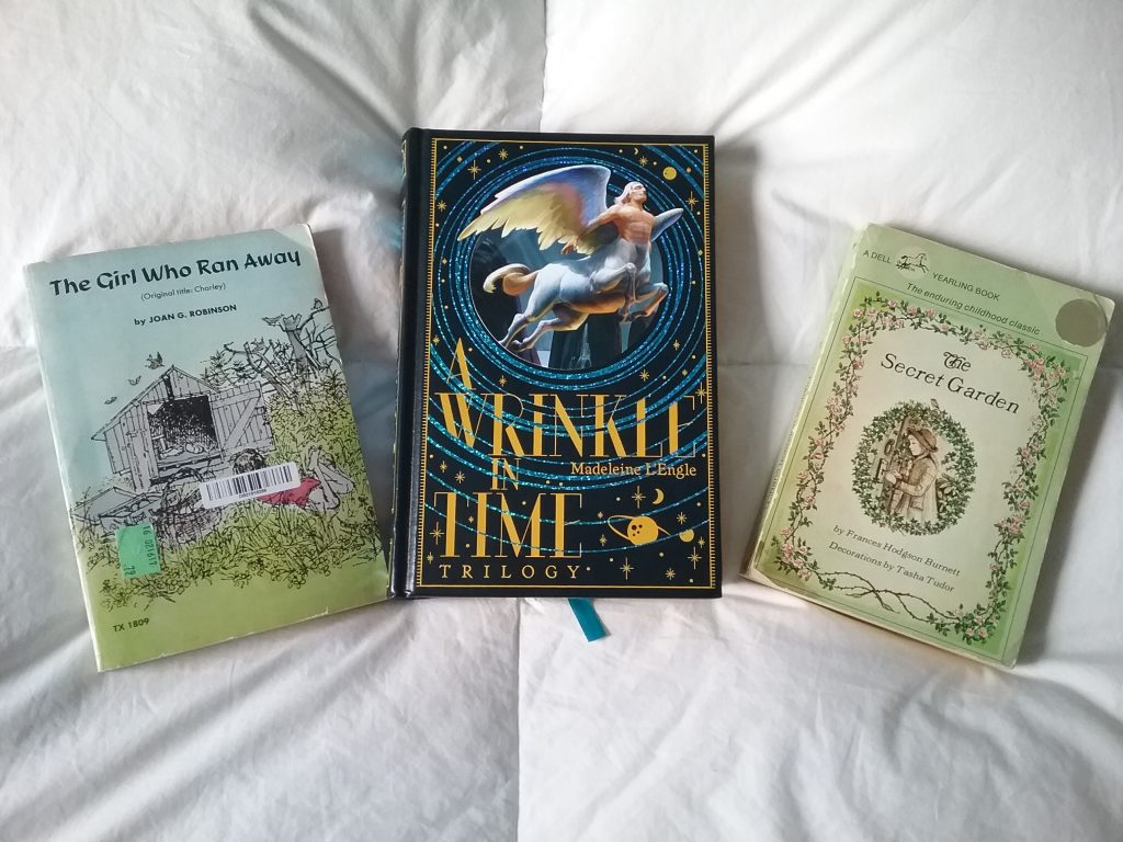 "3 childhood books: ""The Girl Who Ran Away"" (aka ""Charley""), ""A Wrinkle in Time"" trilogy, and ""The Secret Garden."" Photo by Mary Warner, 2018."