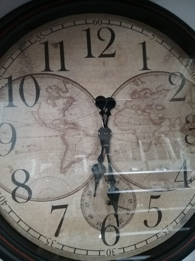 Clock wiith 2 worlds on face, 2018.