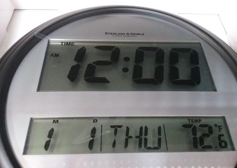 Digital clock set to 12 o'clock, 2018.