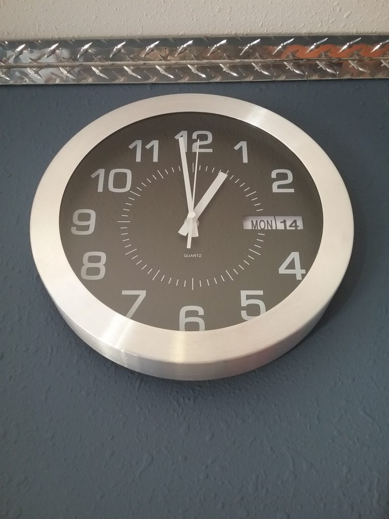 Clock at First Avenue Auto, Little Falls, MN, 2018.