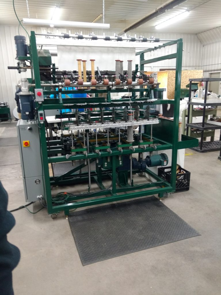 The other side of the spinning machine, which takes single plies of yarn and spins them together to make multi-ply yarn. The Old Creamery Woolen Mill, Randall, MN, 2018.