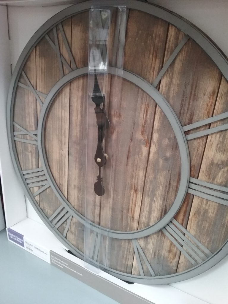 Wood clock with gray metal Roman numerals, 2018.