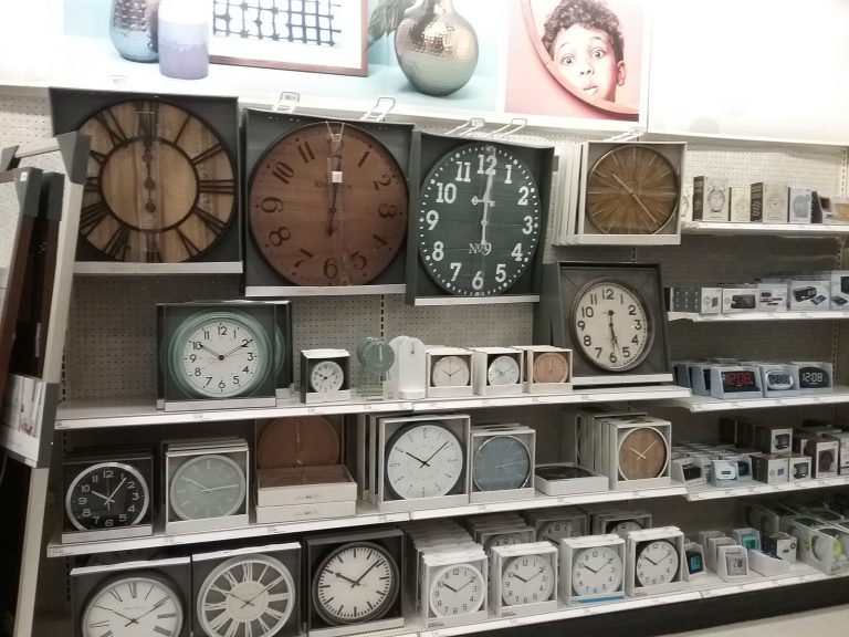 Clocks on display at Target (I think). Check out the budding historian overlooking these clocks in the upper right. I didn't realize I had captured him in the photo along with the clocks but am delighted I did. 2018.