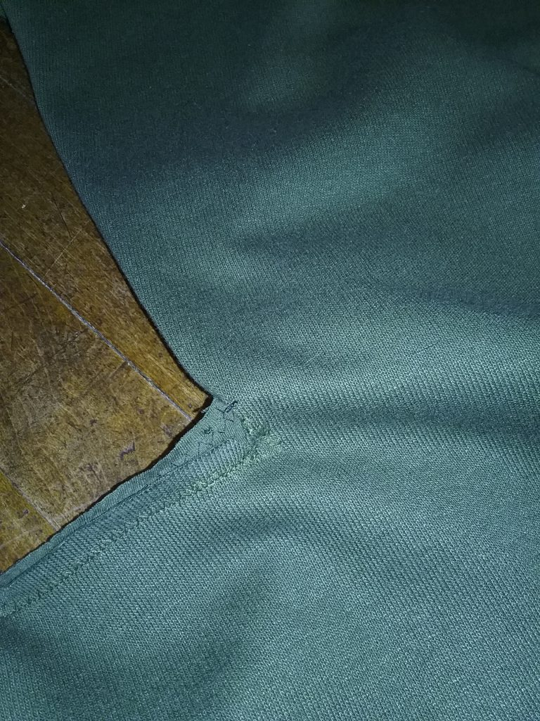 After jettisoning the idea of having a lined bog coat, I sewed up the dark green one. Here you can see how the armpit seam didn't quite line up, which makes the sewing look unprofessional. I couldn't quite figure out how to nuance this part of the coat, what with all the fabric shifting that has to happen to get this design to work. By Mary Warner, May 2019.