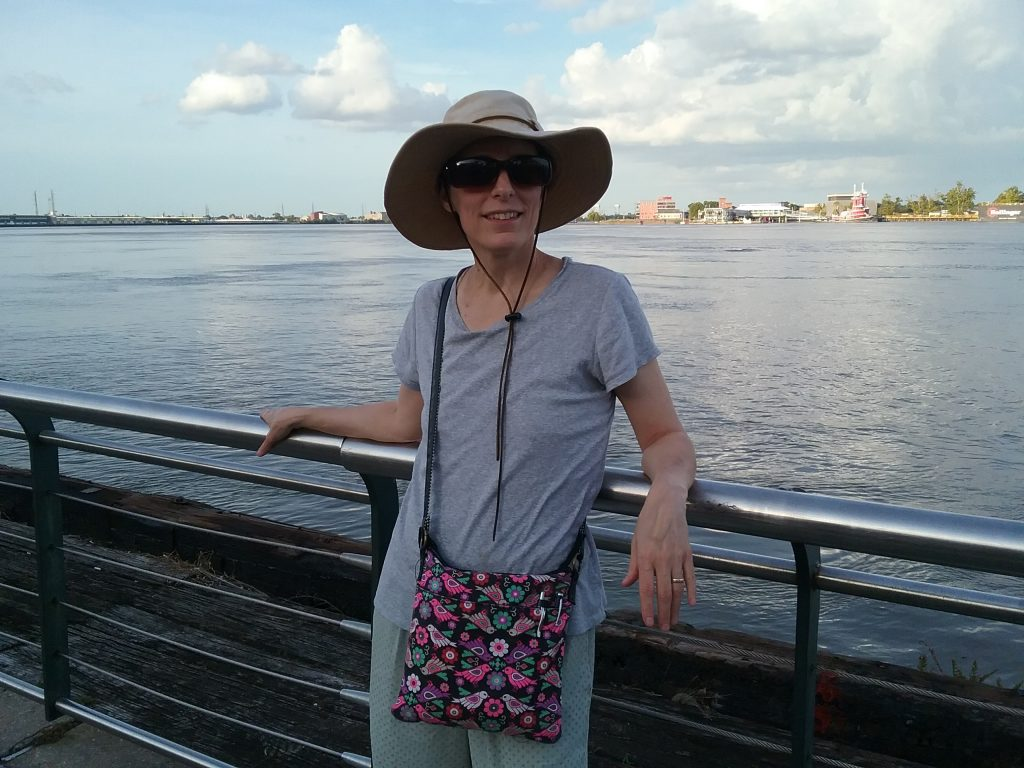 Me, in front of the Mighty Mississippi River, New Orleans, Louisiana, August 2019. Living as I do in a town located on the Mississippi in Minnesota, the state that is the birthplace of the river, the only real goal I set for New Orleans before we left was to see the Mississippi at the southern end. Pretty easy goal to meet as our hotel was only a few blocks away.