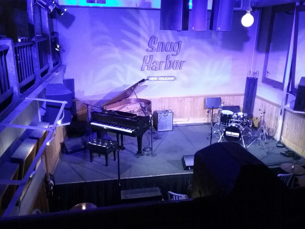 Snug Harbor jazz club on Frenchmen Street, New Orleans, Louisiana, August 2019. Every Friday night this stage is reserved for the great Ellis Marsalis, jazz pianist extraordinaire, provided he's not traveling anywhere. Ellis is the father of the insanely talented Marsalis jazz musicians, Branford, Wynton, Delfeayo (who our family saw at the College of Saint Benedict in March here in Minnesota), and Jason, who joined Ellis on stage as drummer. There was also an upright bass player named Jason (not a Marsalis) and a wonderful singer named Christian, who joined the trio for several songs. (No photos or video were allowed of the performance.) This venue's size matches its name ... once it is filled, it's quite snug, but what a treat to hear these master musicians! It was my husband's wish to see a jazz show in NOLA because NOLA is known for jazz and my hubby loves jazz. Music, too, is part of the community's history.