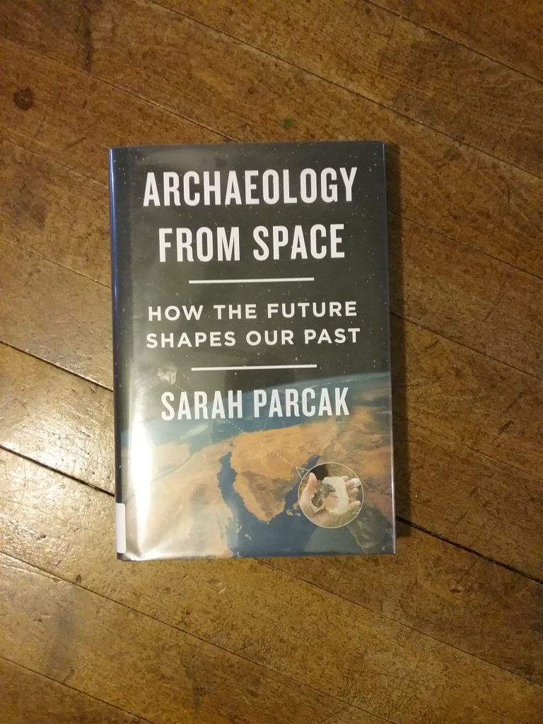 """Archaeology from Space: How the Future Shapes Our Past,"" By Sarah Parcak. Normally, I would have cropped this picture so the book would have taken up most of the frame. Because I'm talking about space in this post, I wanted to give the impression of looking down on the book from on high. Mary Warner, 2019."