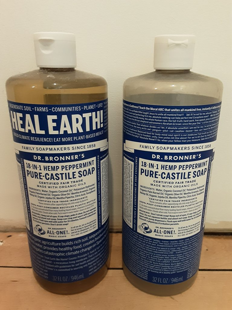 2 bottles of Dr. Bronner's 18-in-1 Hemp Peppermint Pure-Castile Soap, new bottle on left, old bottle on right, May 2020.