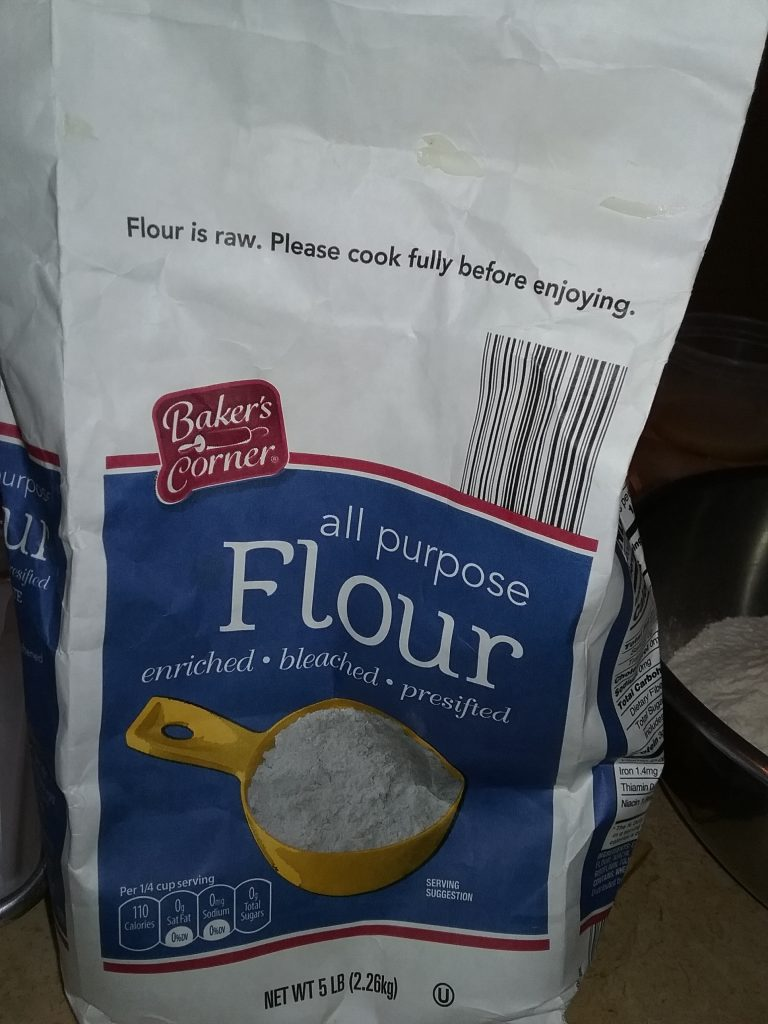 """Baker's Corner All-Purpose Flour, """"Flour is raw. Please cook fully before enjoying."""" October 2020."""