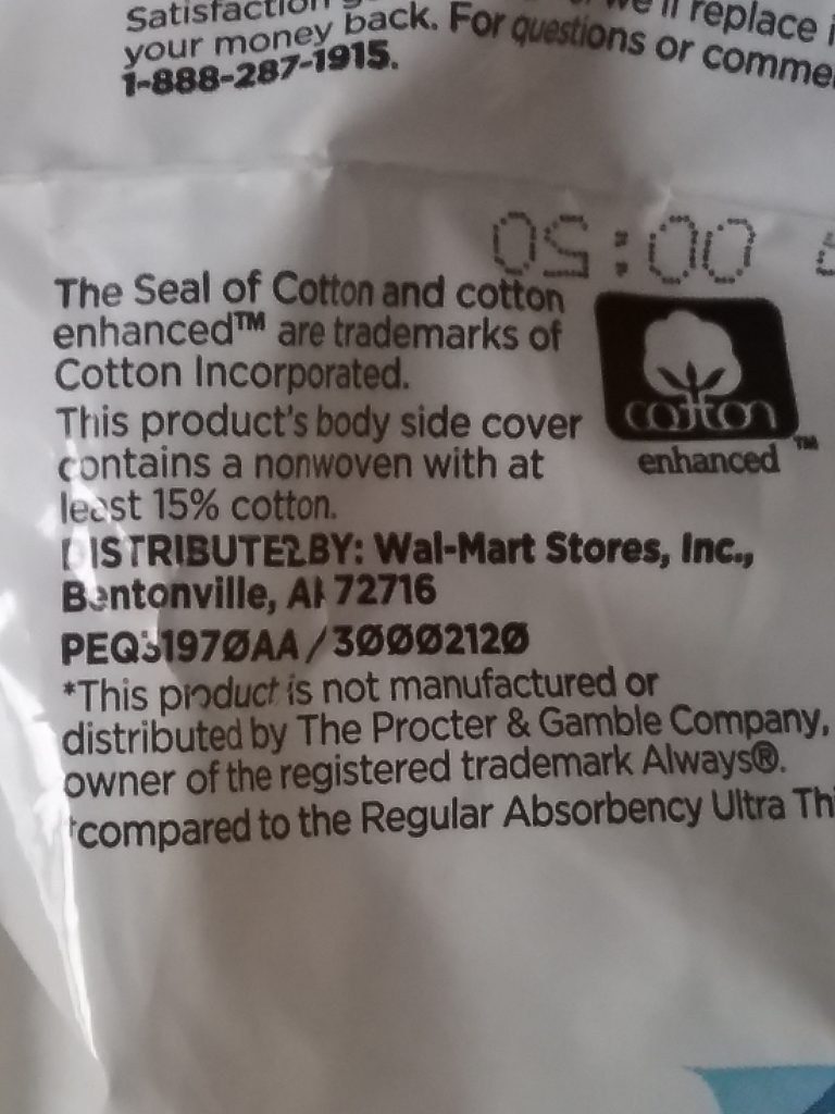 "Close-up of packaging from Equate Ultra Thin Pads from Walmart. Note the ""Cotton Enhanced"" symbol and that the product promises that the ""body side cover contains a nonwoven with at least 15% cotton."" Don't get carried away with the cotton, Equate! November 15, 2020."